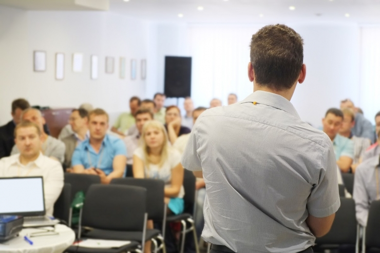 The audience listens to the benefits of employee training